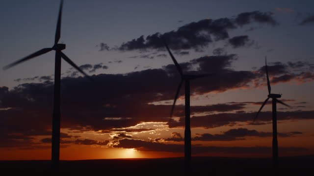 ws wind turbines turning against sunset / zillah, washington, usa   - three objects stock videos & royalty-free footage