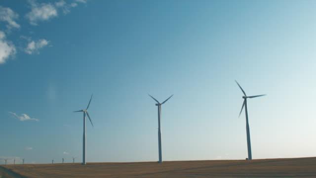 ws wind turbines turning at dusk / zillah, washington, usa        - medium group of objects stock videos & royalty-free footage