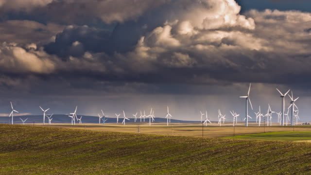 wind turbines with storm clouds - wind turbine stock videos and b-roll footage