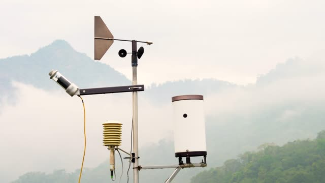 wind vane and anemometer with fog forest background - meteorology stock videos & royalty-free footage