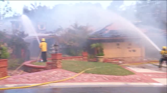 ktla winddriven flames spread uphill from state route 241 and the first home caught fire shortly before noon then additional homes quickly began to... - mittag stock-videos und b-roll-filmmaterial