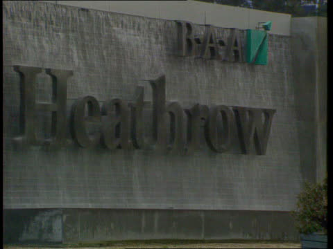 Windfall tax BUSINESS UNIT CLIPREEL Heathrow Ext 'BAA Heathrow' sign with water flowing over it Int GV Airport checkin area North West England TCMS...