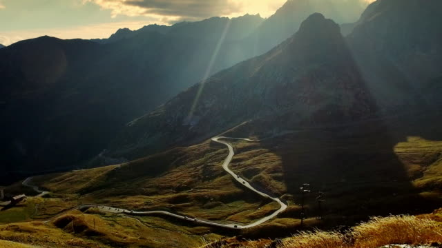 Winding road on the Alps at sunset.