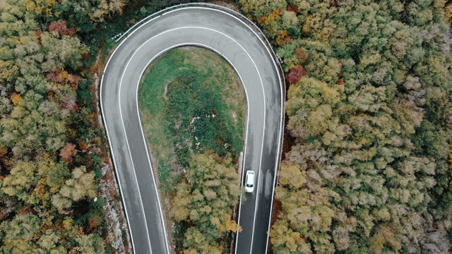 winding road through a forest, car taking a sharp turn - winding road stock videos & royalty-free footage