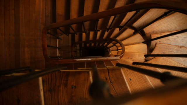winding spiral wooden staircase dezoom - spiral staircase stock videos & royalty-free footage