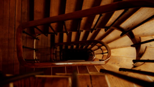 winding spiral wooden staircase - spiral staircase stock videos & royalty-free footage