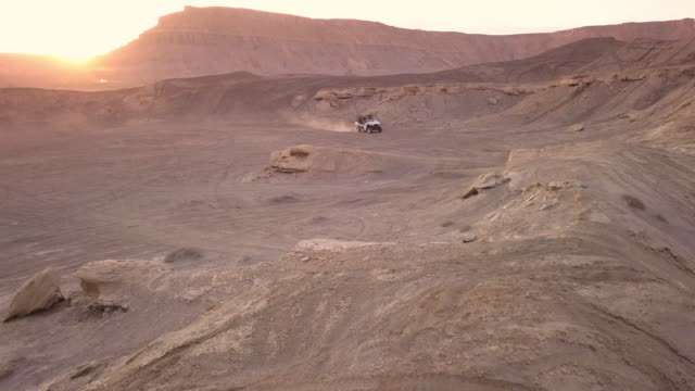 ohv winding through the desert at sunset - sandy utah stock videos and b-roll footage