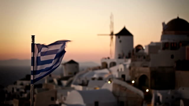 windmill at sunset in oia village. santorini. greece. - oia santorini stock videos & royalty-free footage