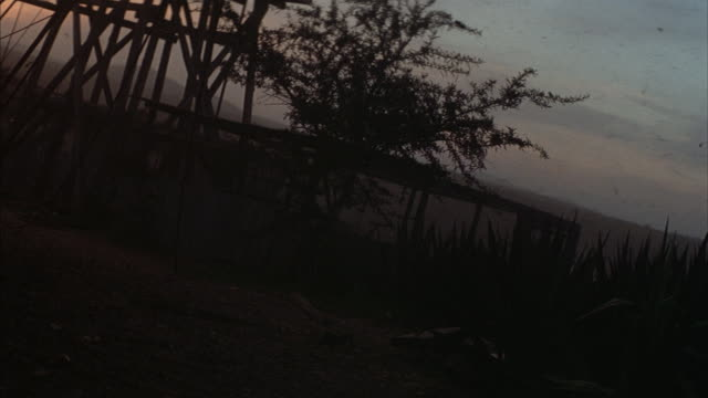 a windmill falls during a windstorm. - schmutzig stock-videos und b-roll-filmmaterial
