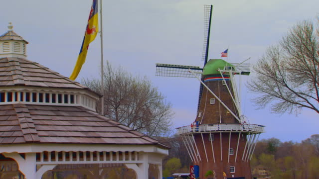 windmill in the background with top of gazebo in foreground - gazebo stock videos & royalty-free footage