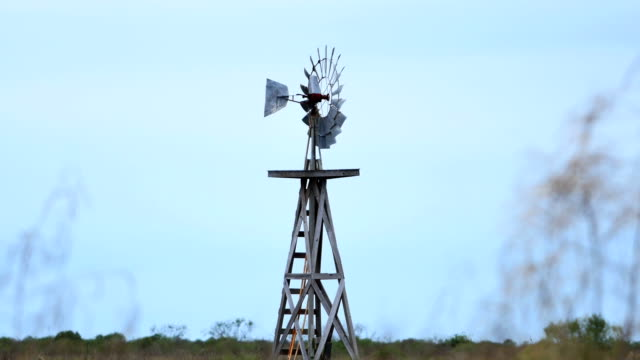 windmill in the desert - arid stock videos & royalty-free footage