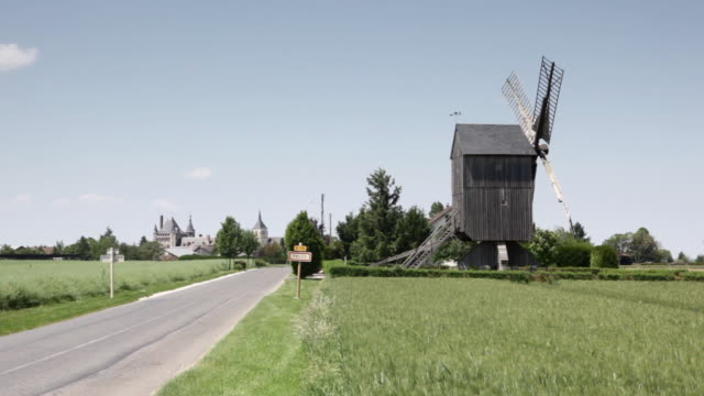 a windmill in the village of talcy, loire valley, loir-et-cher. centre, france, europe - empty road stock videos and b-roll footage