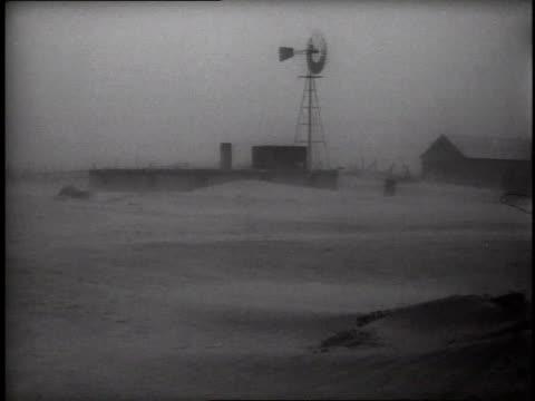 windmill on farm in in dust storm / man running toward windmill - 1937 stock videos and b-roll footage