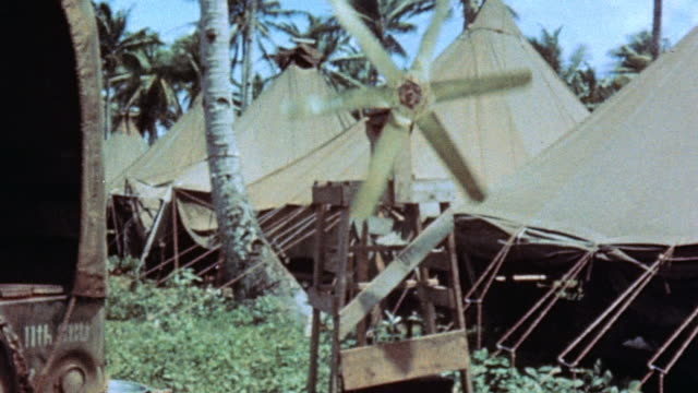 ws windmill sitting outside row of tents at camp / guam mariana islands - guam video stock e b–roll