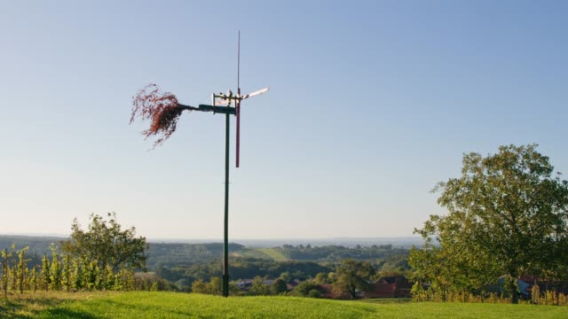 ms windmill spinning in tranquil,idyllic,sunny vineyard,prekmurje,slovenia - prekmurje stock videos & royalty-free footage