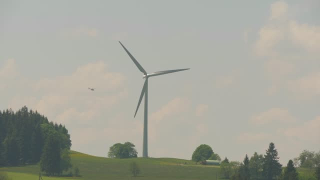 windmill turning in rural landscape - turbine stock-videos und b-roll-filmmaterial