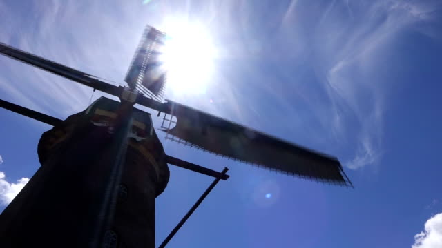 windmill turning in sunny weather in kinderdijk - dutch culture stock videos & royalty-free footage