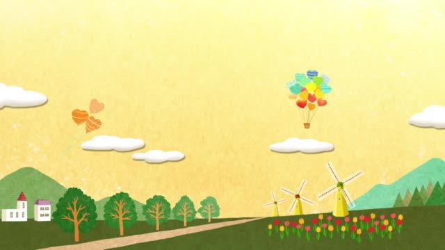 windmill village and heart shaped hot air balloon - 農家の家点の映像素材/bロール