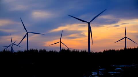 stockvideo's en b-roll-footage met windmills against sky at night, norway - verwerkingsfabriek