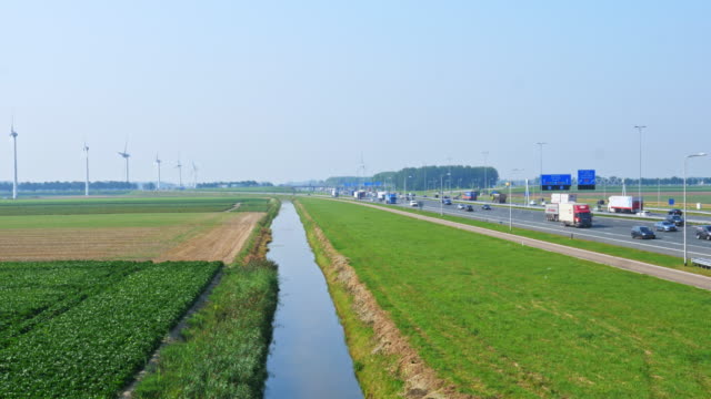 windmills and agriculture and heavy traffic. crowded netherlands - copy space stock videos & royalty-free footage