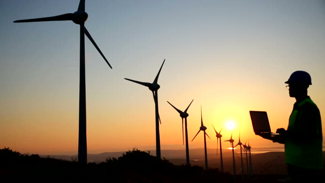 windmills and engineer - environmental conservation stock videos & royalty-free footage
