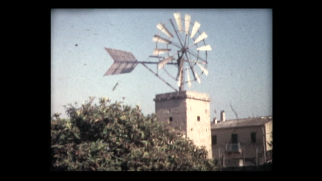 1963 windmills in spanish countryside - bewässerungsanlage stock-videos und b-roll-filmmaterial