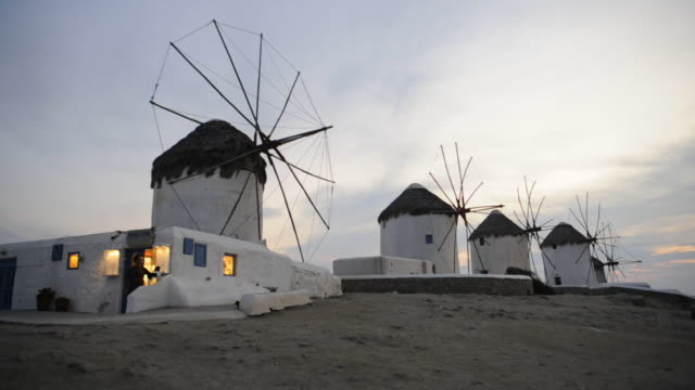 windmills line a bluff at oia, santorini. - oia santorini stock videos and b-roll footage