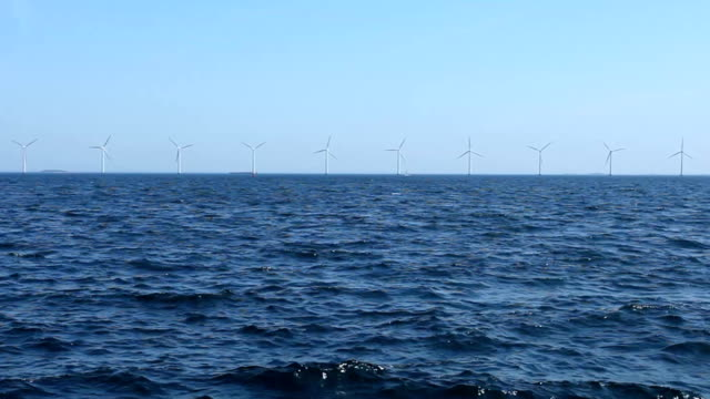 windmills off shore - windmill stock videos and b-roll footage