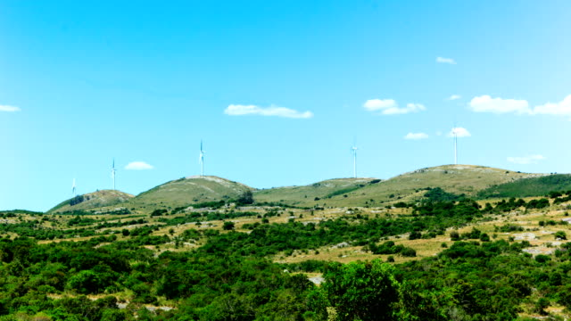 windmills on a hill in uruguay (time lapse), green energy generation - five objects stock videos and b-roll footage