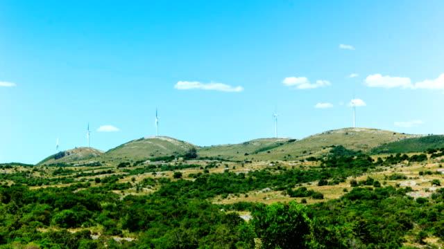 vídeos y material grabado en eventos de stock de windmills on a hill in uruguay (time lapse), green energy generation - cinco objetos