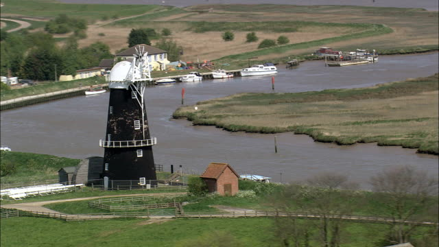 windmills on reedham marshes  - aerial view - england, norfolk, broadland, united kingdom - norfolk england stock videos & royalty-free footage