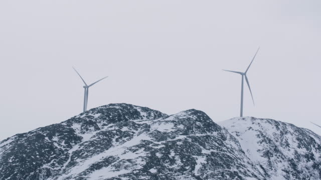 windmills on snow-covered mountains - peter snow stock videos & royalty-free footage
