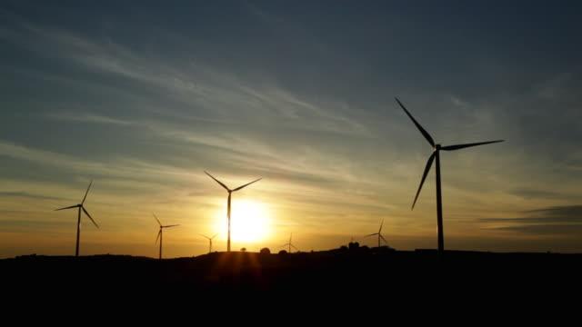 stockvideo's en b-roll-footage met windmills on sunset - silvestre