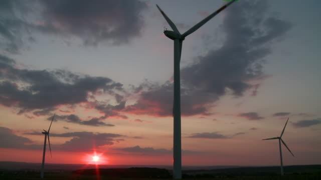 ws windmills rotating at sunset / kirf, rhineland-palatinate, germany - rhineland palatinate stock videos & royalty-free footage