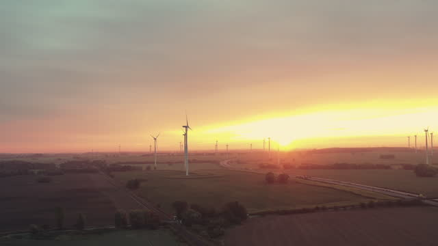 windmills spinning next to highway during dramatic sky - germany stock videos & royalty-free footage