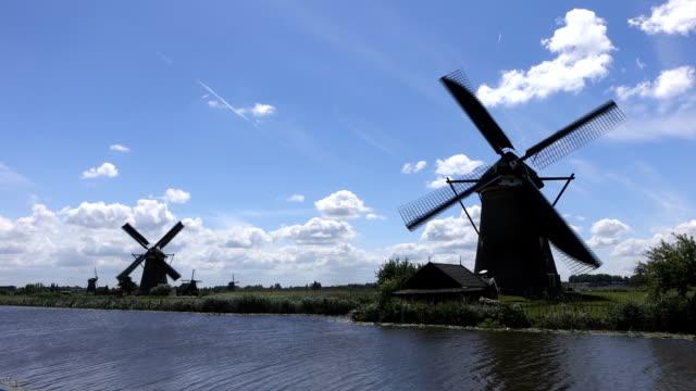windmills turning in sunny weather in Kinderdijk