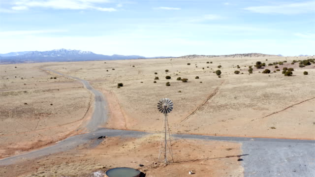 windmill/windpump in the desert - nevada stock videos & royalty-free footage