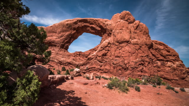 steadycam: window arch in arches national park, utah, usa - arch architectural feature stock videos and b-roll footage