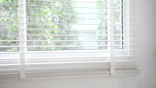 window blinds closing - shutter stock videos and b-roll footage