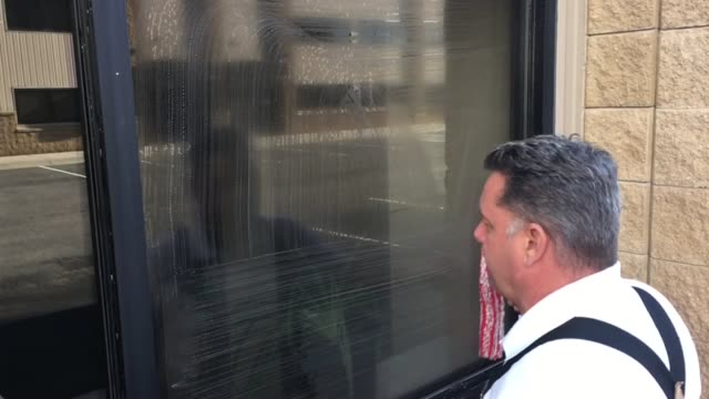 window cleaner cleans in slow motion - suspenders stock videos and b-roll footage