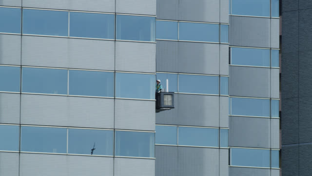 ms window cleaner on building cleaning window / tokyo, tokyo-to, japan - window washer stock videos & royalty-free footage