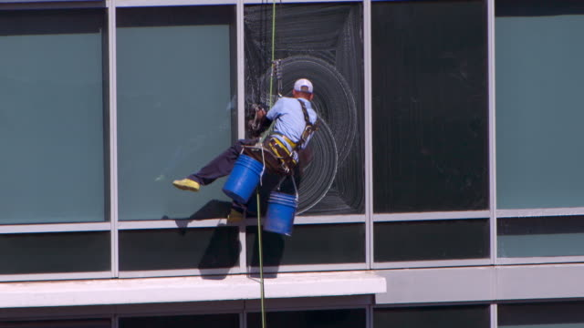 Window Cleaner Repelling from a Hotel in Downtown Austin