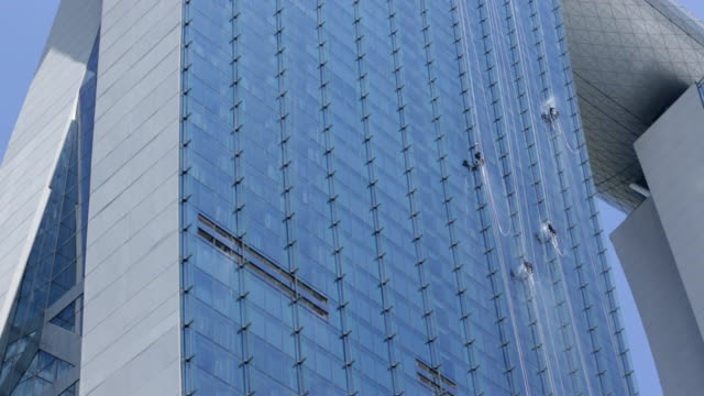 ws window cleaners cleaning windows on marina bay sands hotel - bay window stock videos and b-roll footage