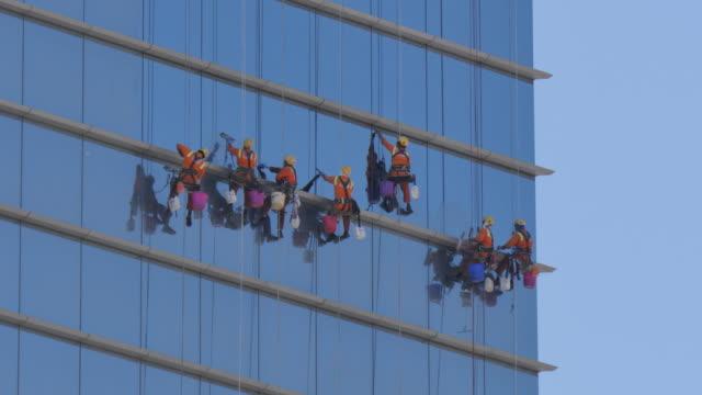 Window cleaners on skyscraper near Capital Garden, Abu Dhabi, United Arab Emirates, Middle East, Asia