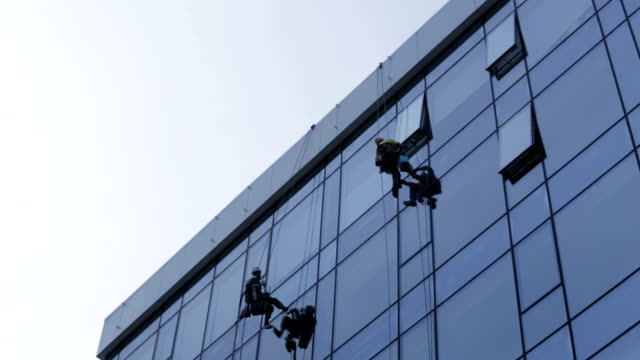 window cleaners - abseiling stock videos & royalty-free footage