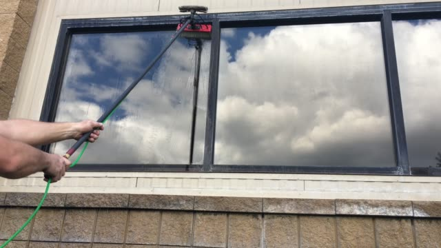 window cleaning with a water fed pole - pole stock videos & royalty-free footage