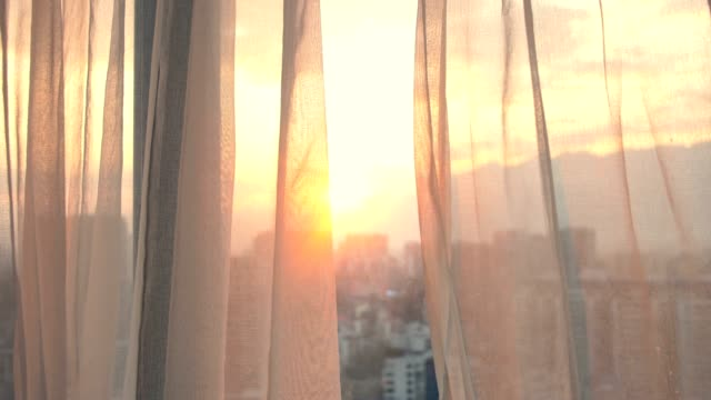 window curtain with morning sunlight - bedroom stock videos & royalty-free footage