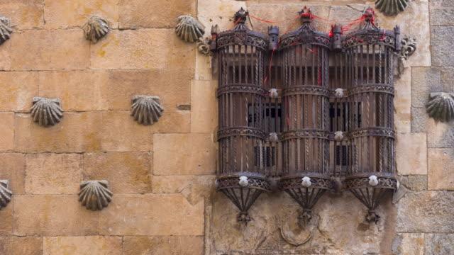 Window in the facade of Casa de las Conchas, Salamanca city, Salamanca province, Castilla y Leon, Spain, Europe