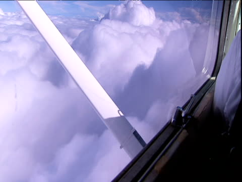 window of light aircraft and wing during flight above clouds venezuela - 空気力学点の映像素材/bロール
