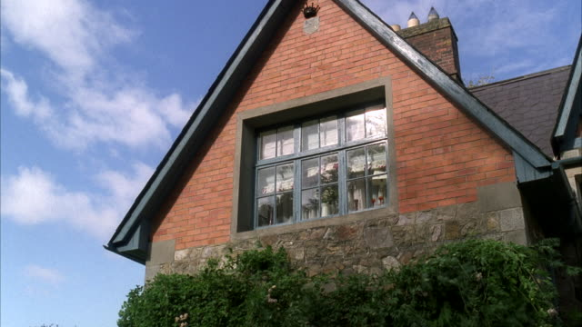 ms window of small country cottage / unspecified  - cottage stock videos & royalty-free footage